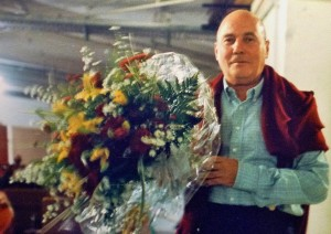 Henze in a rehearsal break-flowers from the musicians. Germany 1989
