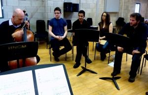 One of the great pleasures is watching my wonderful collaborators/friends at work, inspiring others (and me). Here's Neil Heyde, yesterday morning, working on the new String Quartet by RNCM composer David Curington (at right).