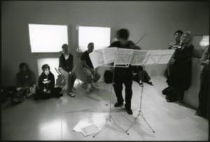 Playing Ernst's transcription of Schubert's 'Erlkonig', surrounded by the work of Meriele Neudecker, Tate St IVes, 2004. Photo: Richard Bram