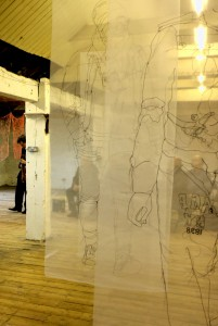 Peter Sheppard and some of the audience, seen through Rosie Jame's translucent drawing s
