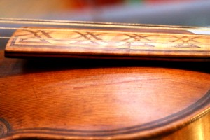 The join between the old and 'mordern' fingerboard.  Some of the marquetry has fallen out