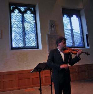 Playing Locatelli 'Il laberinto...' in the concert. Photo courtesy of Thomas Simaku