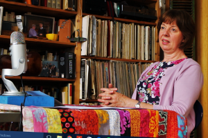The poet at my table. Louise Vale recording at Chimney Court, Wapping (12 7 16). The quilt on the table is by another dear friend, Monika Machon