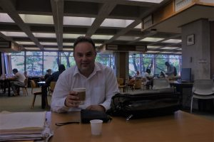 Composer Evis Sammoutis in the Music LIbrary at Ithaca
