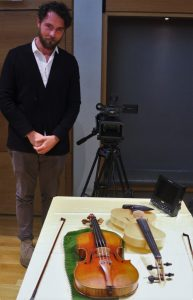 Engineer and designer Luca Alessandrini with his violin and the Viotti Strad